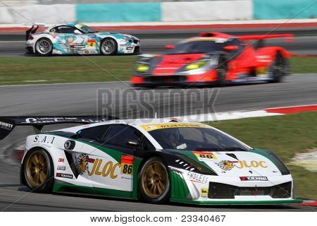 SEPANG - JUNE 19: The Lamborghini Gallardo of the JLOC Team accelerates into turn 2 of the Sepang International Circuit tracks in the Japan SUPER GT Round 3 race on June 19, 2011 in Sepang, Malaysia.