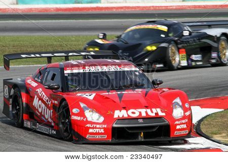 SEPANG, MALAYSIA - JUNE 19: The Nissan GTR car of the NISMO team accelerates into turn 2 of the Sepang International Circuit in the Japan SUPER GT Round 3 race on June 19, 2011 in Sepang, Malaysia.