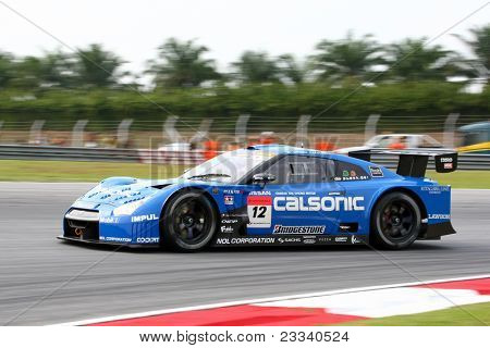 SEPANG - JUNE 18: The Nissan GTR R35 car of Team IMPUL takes to the tracks of the Sepang International Circuit for practice in the Japan SUPER GT Round 3 race on June 18, 2011 in Sepang, Malaysia.