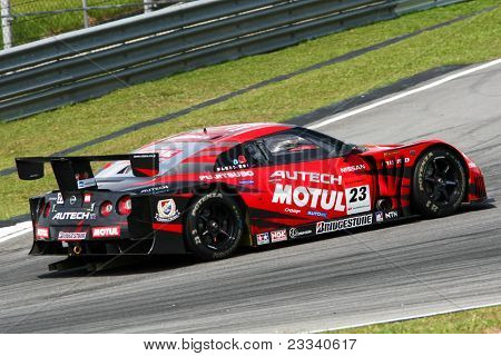 SEPANG, MALAYSIA - JUNE 18: The Nissan GTR car of NISMO team puts in some practice laps in the Sepang International Circuit during the Japan SUPER GT Round 3 on June 18, 2011 in Sepang, Malaysia.