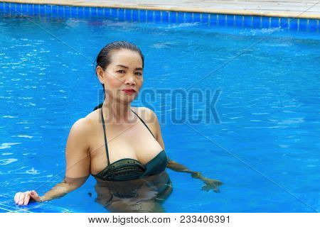 Woman Big Breast Sexy With Bikini Relax Swimming Pool At Bang Boet Beach, Chumphion Province Thailan