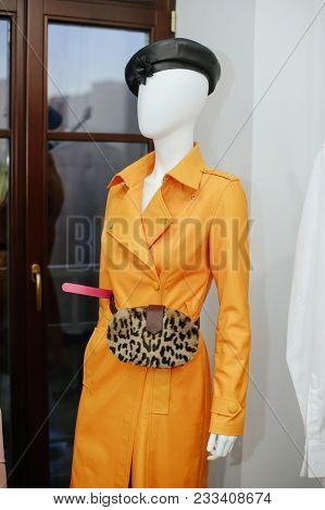 Fashionable Women's Leather Fur Bag On The Manicure In A Yellow Leather Cloak. Sale Of Leather Goods
