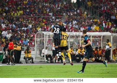 BUKIT JALIL, MALAYSIA - JULY 13: Arsenal's Kieran Gibbs (28) heads away the ball against Malaysia on July 13, 2011 in Stadium Bukit Jalil, Malaysia. English league team Arsenal is on an Asia Tour.