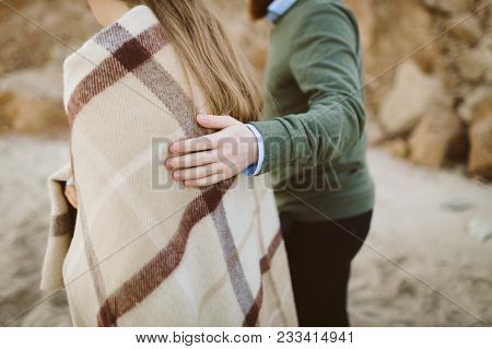 Close Up Of Man's Hands Touching Woman's Shoulders. Artwork. Selective Focus. Rear View