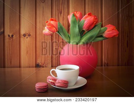 Cup Of Coffee And Tulip  Flowers On Wooden Table