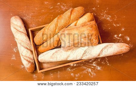 Assortment Of Baked Wheat Bread On Wooden Background. Top View.