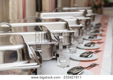 Many White Metallic Clean New Modern Minimalistic Plates In A Row On Table On Wedding Buffet In Cafe