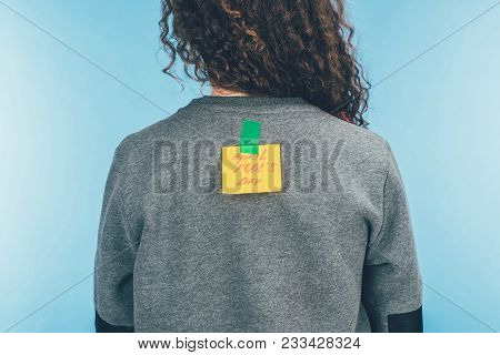 Back View Of Woman With Note On Sticky Tape With April Fools Day Lettering On Back, April Fools Day