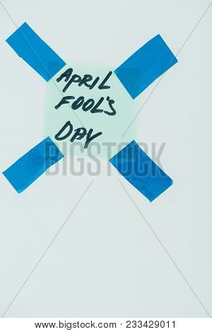 Close Up View Of Note With April Fools Day Lettering And Sticky Tapes Isolated On Grey, April Fools