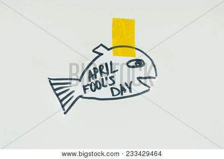 Close Up View Of Hand Drawn Fish With April Fools Day Lettering And Sticky Tape Isolated On Grey, Ap