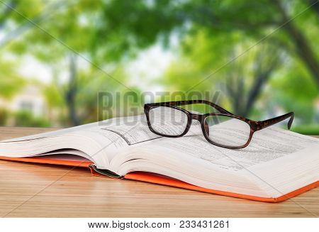 Book Glasses Close Up Reading Glasses Book Shelves Table Background