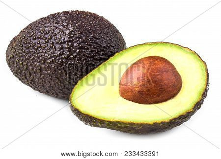 Avocado Isolated On White Background. Black Avocado Haas Close Up May Use For Product  Package Desig