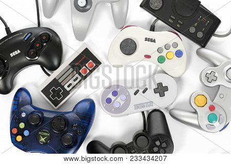 Taipei, Taiwan - February 19, 2018: A Collection Of Retro Video Game Controllers Shot From Above On