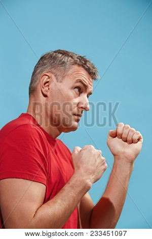 Hate, Rage. Angry Emotional Man On Blue Studio Background. Emotional, Young Face. Male Half-length P