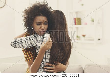 Woman Hugging Her Depressed Friend At Home, Closeup. Young Girl Supporting Her Crying Girlfriend. Fr