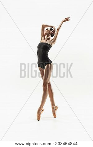 Modern Ballet Dancer Exercising Isolated In Full Body On White Studio Background. Ballerina Or Moder