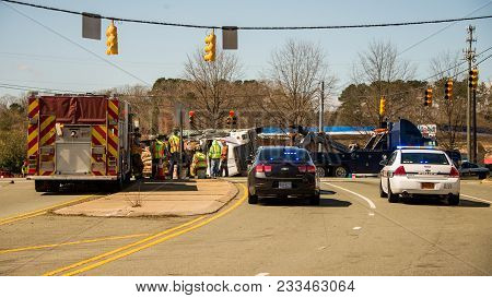 March 10, 2017:carrboro North Carolina Us-police Cars And Fire Trucks With Overturned Logging Truck