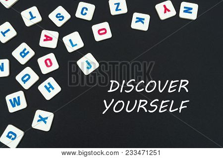English Colored Square Letters Scattered On Black Background With Text Discover Yourself. English La