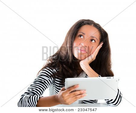 Beautiful mixed race teen girl, working with a portable tablet computer whilst daydreaming - isolated on white