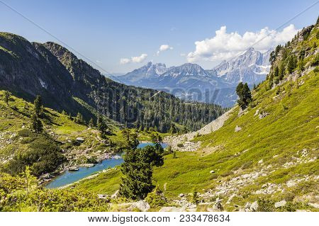 View To Blue Lake Spiegelsee Mittersee And Distant Mountains Gosaukamm, Roetelstein And Dachstein In