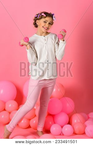 Sport, Morning Exercise, Weight Lifting, Pink Background. Childhood, Health, Workout. Child With Dum
