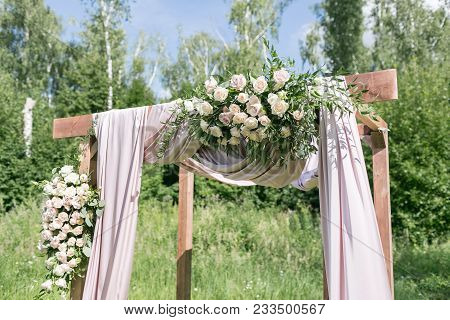 Beautiful Setting For Outdoors Wedding Ceremony Waiting For Bride And Groom And Guests. Wooden Chair