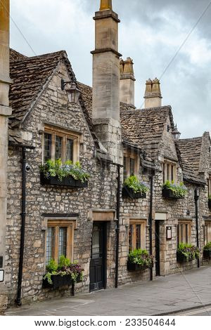 Old slate roof stone houses decorated with flowers in Bradford on Avon, a town and civil parish in West Wiltshire, Southwest England, UK