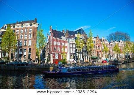 Amsterdam, Netherlands - April 19, 2017: Canal, Boats And Houses In Amsterdam. Amsterdam Is The Capi