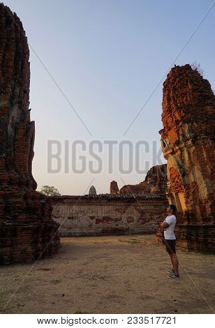 Ayutthaya, Thailand - 22 April 2016: A Tourist Is Admiring The Stupa In An Old Monastery.