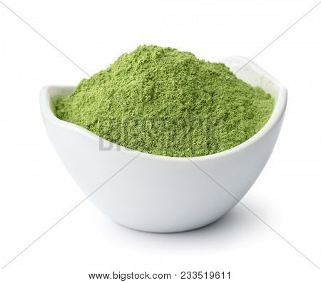Ceramic bowl of henna powder isolated on white