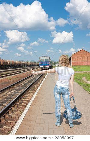 Woman Hailing Train