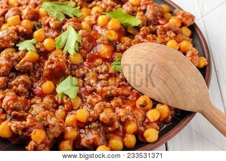 Traditional Cuisine. Mexican Chili With Chickpeas Bi And Wooden Spoon On A Wooden Table