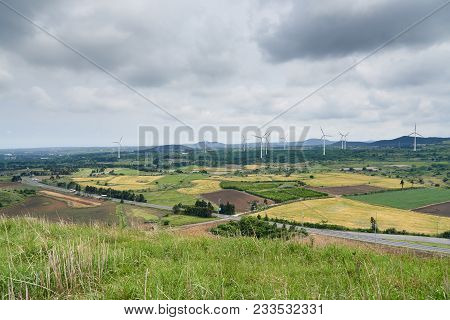 Picturesque Landscape Of Farm Field With Wind Generator, View From Yongnuni Oreum (yonganak), A Para