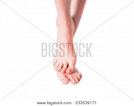 Beautiful Well-groomed Female A Foot And A Heel On A White Background.