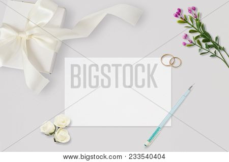 Styled Stock Photo. Feminine Wedding Desktop Mockup. White Roses, Satin Ribbon, Beads On Pastel Gray