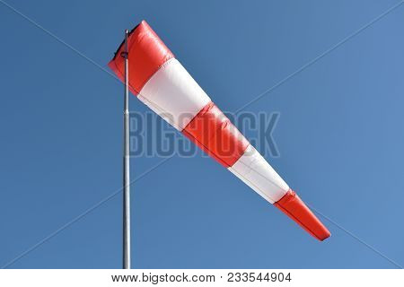 Wind Cone Against Blue Sky. Windsock In Windless And Perfect Flying Weather