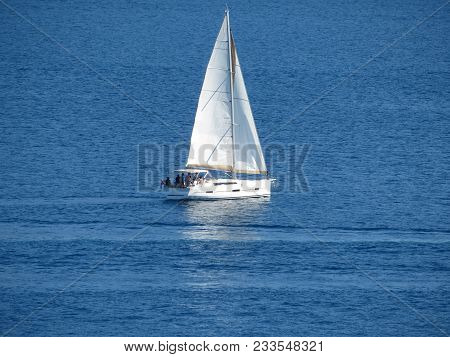 Sailboat In The Open Sea. Single Mast Yacht, World Cruise