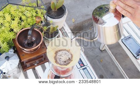 Hand Drip Coffee, Barista Pouring Hot Water Over Roasted Grinded Coffee Powder Making Drip Brew Coff