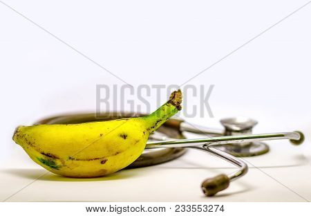 Banana And Stethoscope Isolated In White Background As Doctor Recommendation Health And Nutrition Pu