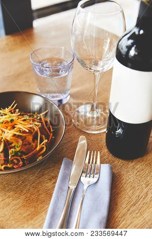 Udon Noodles With Pork Served On Table With Wine