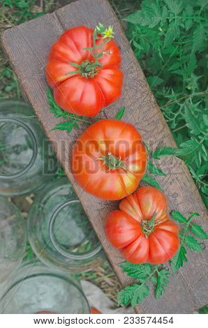 Canning Tomatoes In Glass Jars Outdoors