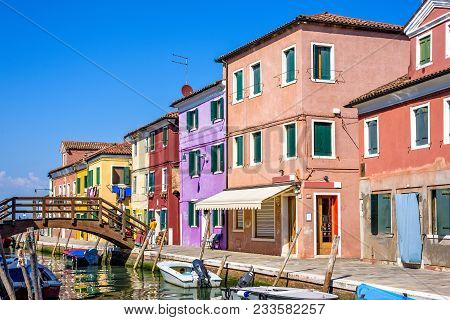 Daylight View To A Street With Colorful Buildings And People Wal