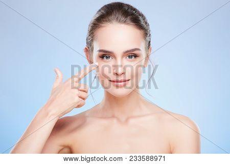 Beautiful Woman Pointing At Cheekbone