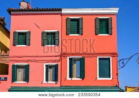 Daylight View To Vibrant Colorful Yellow Building