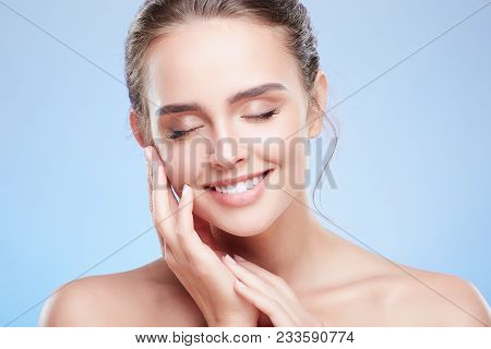 Smiling Woman With Closed Eyes