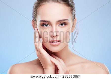 Portrait Of Woman Touching Face