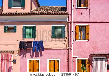 Daylight View To Vibrant Pink House Front Facade