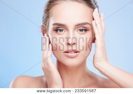 Woman Touching Face With Both Hands