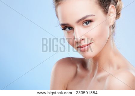 Woman Looking At Camera With Light Smile