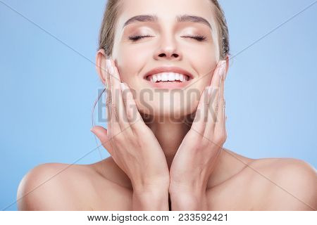 Beauty Portrait Of Happy Woman With Closed Eyes